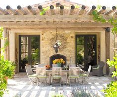 outdoor dining area with fireplace featured in Better Homes & Gardens