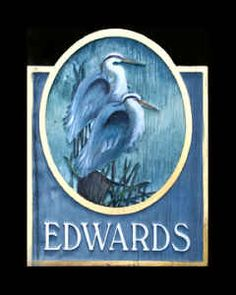 Custom residential,house sign with illustration of blue heron shore birds by THE SIGN MAN of North Myrtle Beach, South Carolina.  Facebook page Residential Signs by The Sign Man.  email: wodinart@aol.com.  phone: 843-272-3820.