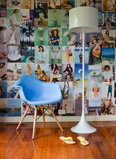 Magazine wall collage and a sky blue Eames chair. But I want to do one with all the places I want to travel to...