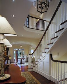 stair and paneling idea, like the curved railing on lower, could work with opening to basement stairs