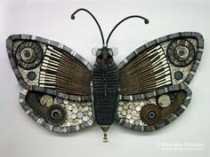 © Michelle Stitzlein | Found object sculpture.  Look at the piano keys in the upper wings!  Wouldn't this be beautiful in the Garden?