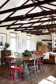 Gorgeous timber beams | mismatched chairs | via http://www.homelife.com.au/
