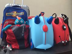 Are backpacks or kids suitcases better when travelling with children? In the photo we have adult and child rolling suitcases, a backpack and our two trunkis, all useful on different trips