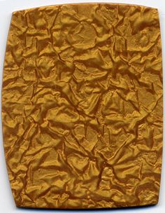 Victoria James texture sheets. Crumpled Foil mica shifts like crazy. This gold polymer clay is completely flat, the 3-D look is an illusion.