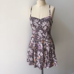 Free People calico floral mini slip dress Boho calico mini floral print mini slip dress in tones of mauve and peach from Free People. Adjustable spaghetti straps. Elastic at back neckline for a close fit. Open back with twisted jersey straps. Fully lined; 100% rayon. Size 4- fits true to size. Free People Dresses