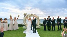beach wedding at Extravagant Wedding at The Breakers Palm Beach by Domino Arts Photography Breakers Palm Beach, The Breakers, Bride And Groom Pictures, Wedding Pictures, Domino Art, Bridesmaid Dresses, Wedding Dresses, Flower Wall, Backdrops