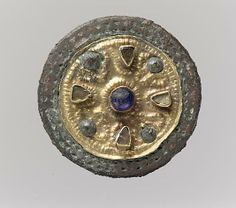 550-650 AD. Disk Brooch Gold, glass, copper alloy, glass paste cabochons Dimensions: Overall: 1 1/16 x 3/8 in. (2.7 x 1 cm)