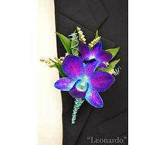 Blue dyed dendrobium orchid boutonniere with aqua wire accent.