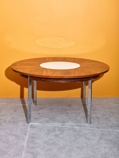 """Iconic vintage 1970's Milo Baughman dining table with built-in lazy susan. Extremely rare and special collectors item featuring sleek chrome legs, rosewood veneered top, and built in white revolving server. This stunning dining table was meticulously designed to last timeless generations. In great vintage condition. 28"""" H x 54"""" DIA Monthly Payments with Affirm available at checkout. *Shipping rates do not accurately represent shipping costs for furniture. Contact shipping@comingsoonnewyork.com f Round Dining Table, Dining Room Table, Lazy Susan Table, Milo Baughman, Chrome, Legs, Furniture, Vintage, Design"""