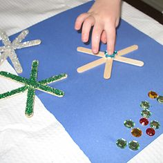 snow flakes- easy to do with the kids that they can hang in the room!