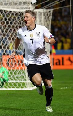 Bastian Schweinsteiger of Germany celebrates scoring his team's second goal during the UEFA EURO 2016 Group C match between Germany and Ukraine at Stade Pierre-Mauroy on June 12, 2016 in Lille, France.