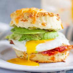 the best breakfast sandwich is made with a fried egg, bacon, and avocado on a homemade cheddar cheese and green onion biscuit. Best Breakfast Sandwich, Biscuit Sandwich, Best Sandwich, Sandwich Recipes, Grill Breakfast, Breakfast Ideas, Easy Cheddar Biscuit Recipe, Cheddar Biscuits, Cheddar Cheese