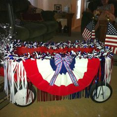 Kid's wagon turned into a parade float:) @Ruthlyn Hamilton Atkins what do you think about this one?