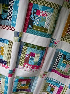 echino log cabin quilt top finished! by { philistine made } I like the sashing.