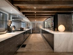 Inside, the design is classical, yet also modern. The kitchen has rustic exposed ceiling beams and vintage light fixtures.