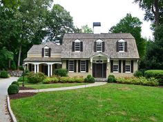 There are some types of roof that would create a traditional house style and a gambrel roof is one of them. A gambrel roof is a symmetrical two-sided roof that has two slopes on each side of the ro… Dutch Colonial Exterior, Colonial House Exteriors, Dutch Colonial Homes, Style At Home, Roof Styles, House Styles, Mansard Roof, Gambrel Roof, House Landscape