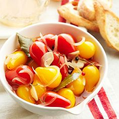 Pickled Pear Tomatoes with Rosemary- Vinegar & a bit of rosemary go a long way in flavoring these peppery tomatoes. Set them out as part of a charcuterie tray or serve them alongside an entree of lamb, roast beef, or pork. Yield: 7 half-pints, Prep: 35 mins, Cook: 10 mins, Process: 15 mins