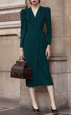 This Ulyana Sergeenko Long Sleeve Wrap Midi Dress features leg-o'-mutton sleeves and a wrap styled silhouette.