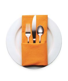 Fold the napkin in half horizontally, edges facing away from you. Fold the top open edge down to the center fold, then turn the napkin over. Fold in the right side, then the left, so that they overlap in the center. Turn the napkin over again. Fill the pocket with silverware.