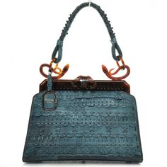 Im not really into fashion (except selling) but I love this purse. Especially the snake handle attachments.    CHRISTIAN DIOR Leather Samourai 1947 Armour Frame Bag LE.   This extraordinary tote is beautifully crafted of elaborately woven teal green leather.