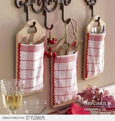 Cutlery hangers made from chopping boards and tea-towels.