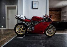 Ducati Motorcycle - Classic 998 faired bike with Ducati picked out in carbon. Front and rear number boards with gold piping and black belly pan. Ducati Cafe Racer, Ducati Motorbike, Ducati Superbike, Cafe Racers, Ducati 916, Aryton Senna, Motorcycle Types, Sportbikes, Hot Bikes