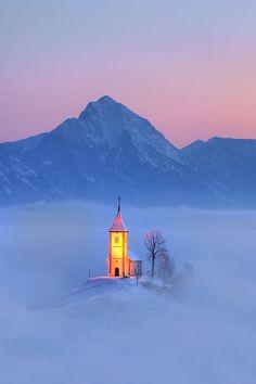 Sunrise in Church of Saints Primus and Felician, Jamnik, Julian Alps, Slovenia