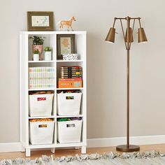Pin for Later: 10 Nursery Storage Hacks to Help You Save Space Maximize Floor Space For any furniture you buy, think tall and thin, like Land of Nod's Cubic Bookcase ($399).