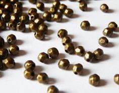 fr_50_perles_a_facettes_metal_bronze_3mm_