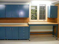 So Functional. http://www.nuvogarage.com/wp-content/uploads/garage-cabinets-rolling-workbench-workstation-slatwall-wall-organizers-garage-flooring-window-1024x768.jpg