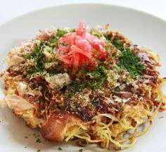 Hiroshima Okonomiyaki | Okonomiyaki, the revered king of Japanese street food is a large, thick savoury pancake stuffed with cabbage, bean sprouts and meat or seafood. Topped with with swathes of okonomiyaki brown sauce, Japanese mayonnaise and seaweed just thinking about this beast of Kansai cuisine gets our mouths watering and did you know there's more than one version to try?