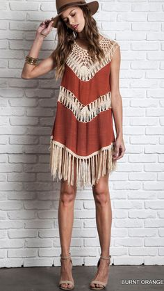 Unique pattern of crochet and contrasting fabric creates a v-shape color block design. Sheer crochet panels for a one of a kind look. Beautiful crochet detailing around the neckline. Long fringe along the bottom hem. Crochet Fringe, Crochet Tunic, Crochet Top, Bolero Crochet, Crochet Dresses, Ethno Style, Burnt Orange Dress, Fringe Dress, Fringe Tank