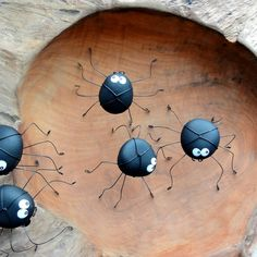 Make playful spiders from the tumbled rocks then leave them around the garden for the children to find.