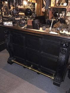 Gorgeous old bar with carved gothic lions and big paw feet, heavy, solid oak with brass top and foot bar rail. The old brass top and foot rail