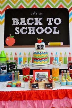 Back to School party. Fun use of primary colors: red, blue, yellow, green. The colored pencil backdrop is so cute!