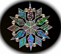 stained glass snowflake suncatcher (design 12). $35.00, via Etsy.