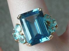 Vintage 14k yellow gold cocktail ring with emerald cut and pear cut blue topaz, shades of teal and peacock