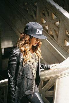 this girl looks absolutely amazing with her baseball cap and leather jacket. she is rocking it!