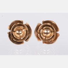 Lot 251 A PAIR OF GOLD FLOWER FORM EARRINGS Est: $150 - $250 Description A Pair of 14kt. Yellow Gold Flower Form Earrings. Total weight: 3.2 dwt.