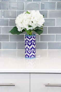 Gray and White Kitchen | White Quartz Countertop Kitchen | Gray Kitchen Cabinets | Glass Subway Tile Backsplash | Blue and White Vase with Flowers | Blue and White Vase Décor | Kitchen Decorating Ideas | Modern Cabinet Pulls | Stainless Steel Cabinet Pulls