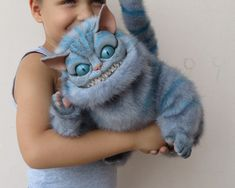 Cheshire Cat, handmade by Vladimir Sukhanov, of polymer clay and faux fur (Tim Burton type). $350. / Etsy