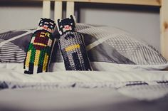 Cross-stitched Batman & Robin dolls