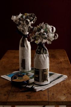 Here's a simple and beautiful way to wrap a bottle of wine: Wrap it in newspaper and use scissors to cut strips to the top of the bottle. Then curl away with scissors!