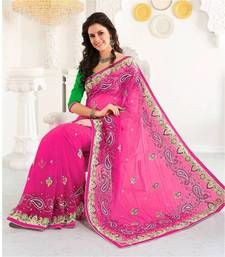 Pink color saree crafted on Net and Raw Silk material. The saree is edged with machine embroidery which runs throughout it. The saree is accompanied with green color blouse piece which is contrasting the saree giving an elegant look.