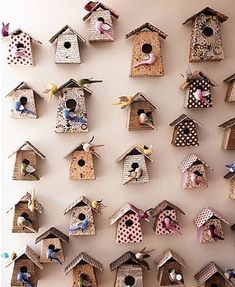 I just about died when I saw this birdhouse wall. What a great statement piece and hello my little girls room already has a bird theme in i...