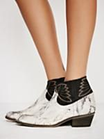 Dorado Ankle Boot | Cool western-inspired leather ankle boot with a small block heel for a comfortable step. Features a textured print from the wild and an effortless, wide opening at the ankle. Embroidered details complete the look.