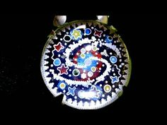 My film from the Gold-Glue series shows the production of: Silver Cloisonne enamel pendant with rock crystal cabochon. Filigreen Universe Goldsmiths Enamel w...