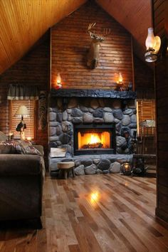 ♥ Fireplace of Rustic Cabin, Cottage or Lodge ♥ Wood above fireplace covers chute.
