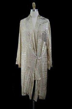 1920s Rare Assuit Flapper Coat. One of the holy grails of vintage this is a spectacular original 1920s Assuit Flapper coat. The technique used to make this has been done for a very very long time and is still done today but not to the same degree and quality of the pieces done in the twenties. The base is a fine cotton mesh which then has silver hammered onto it and folded - in essence the metal is wrapped around the mesh to form that fantastic design.