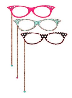 50's Diner Theme Party: Cat Eye Glasses props for photo booth.